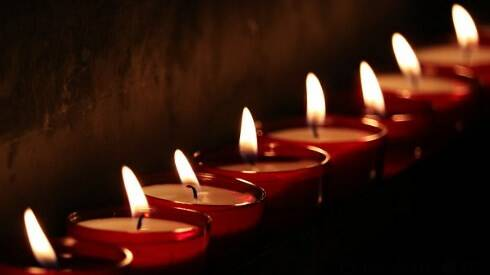 Candele a lutto.